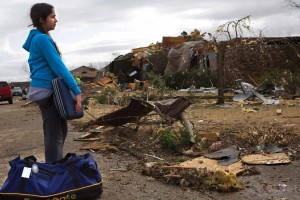 Aruniti Manawa stands near her neighbors' Harrisburg homeas she waits for her family to gather some belongings from their damaged home. Manawa's father, Dr. Brahm Jyot, had moved his family to Harrisburg from Chicago eight months earlier. | STEVE MATZKER