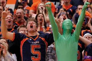 "Curtis Pitt and ""The Green Man"" lead a senior class chant supporting the football team during the homecoming pep rally. © Pat Sutphin"